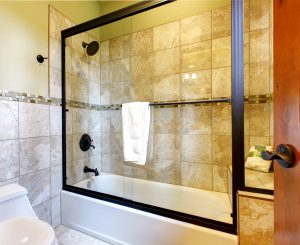 Top quality shower bath tub with stone tiles and toilet.