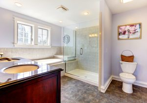 Light lavendar bathroom with large shower and sink.